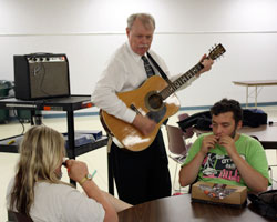 LEAP students play harmonica with Frank Strong playing guitar.